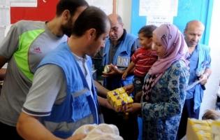 Foto UNRWA. Reparto de alimentos a miles de familias desplazadas en Gaza (2)